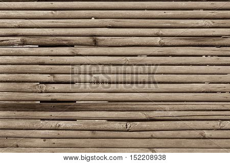 old wooden shafts or corrugated texture of uneven background of sepia color