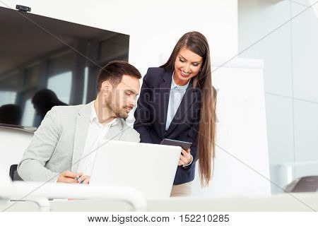 Young beautiful professionals work in modern office