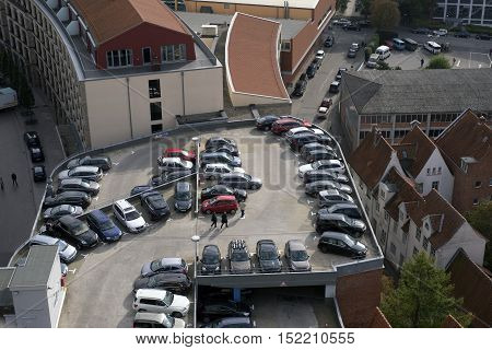 LUBECK GERMANY - OCTOBER 13 2016: Aerial view of Lubeck oldtown in Germany with parking garage and parked cars. Lubeck is listed by UNESCO as a World Heritage Site.
