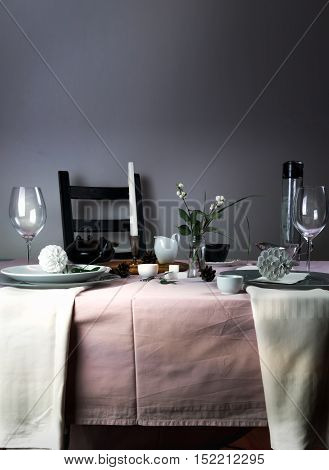elegant table setting. Christmas. romantic dinner - a table with a tablecloth, cutlery, candles, flowers, buds