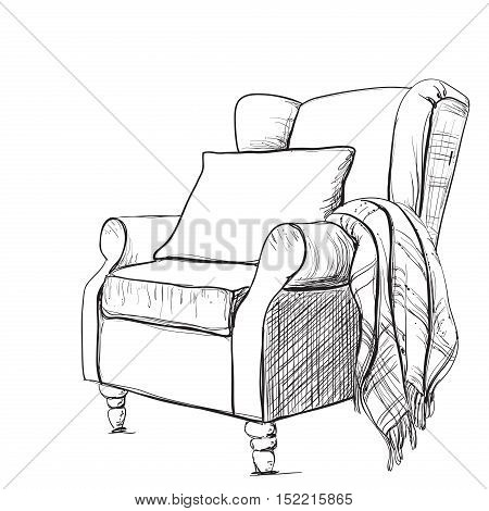 A cozy armchair and a warm blanket. Relaxing atmosphere.