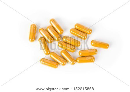 Close up turmeric capsule on white background