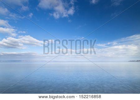winter frozen lake / winter peaceful landscape deserted place