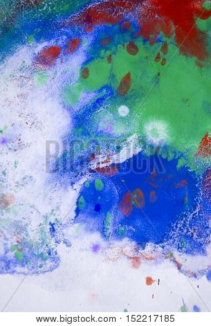 red, blue and green spots on the surface of the melt, vaporize