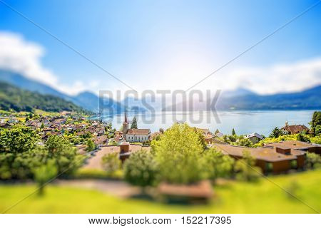 Landscape view on Weggis village on Lucerne lake with beautiful mountains on the background in Switzerland. Tilt-shift image technic