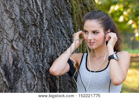 Woman Wearing Earphones And Getting Ready For Running