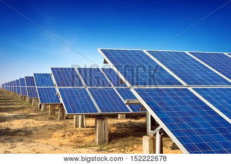 Blue sky background green energy solar panels