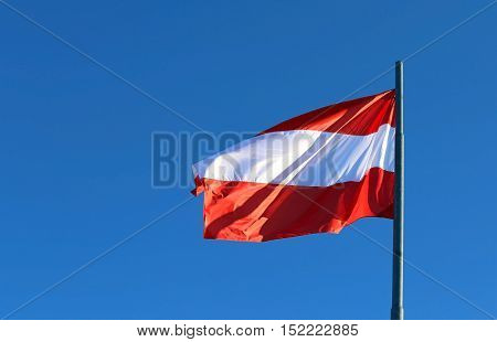 Great Austrian Flag Waving In The Blue Sky