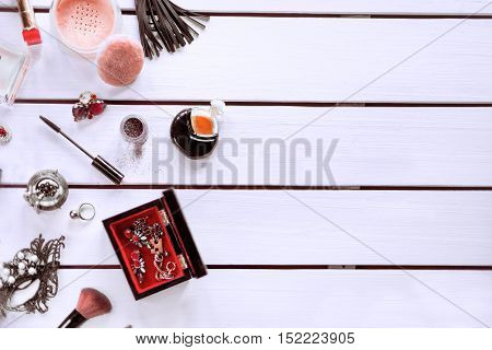 Table top photo Female cosmetic, small bottle of perfume and different accessories on a white background