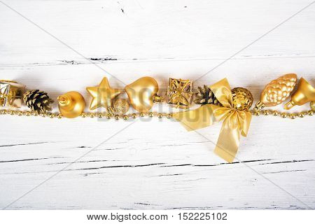 Brilliant gold baubles like christmas decoration. Yellow balls ribbon gift bow and tinsel isolated on white background.
