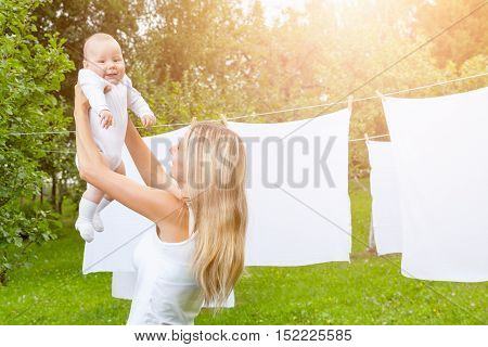 Beautiful Mother And Baby Playing Together Outdoors