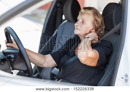 Elderly Woman Behind The Steering Wheel