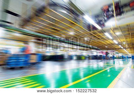 Production of automobile engine plant motion blur picture.