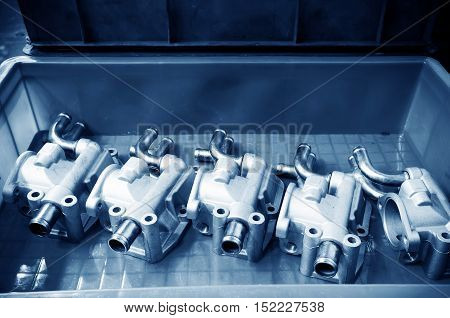 Parts on the production line of the automobile manufacturing plant: pump close-up.