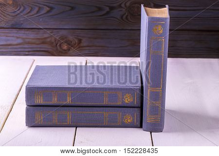 purple three old books isolated on white background