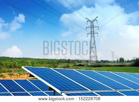 Solar Panel With High Voltage Tower in Background