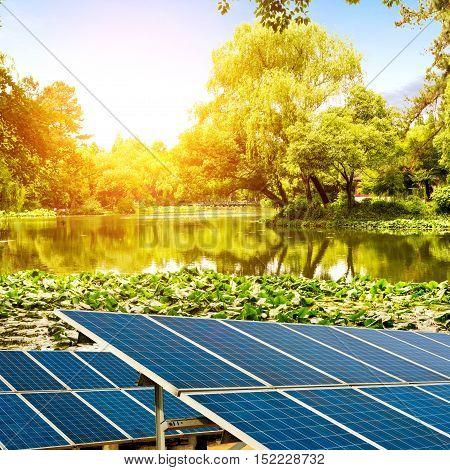 At dusk the lake and lakeside solar panels