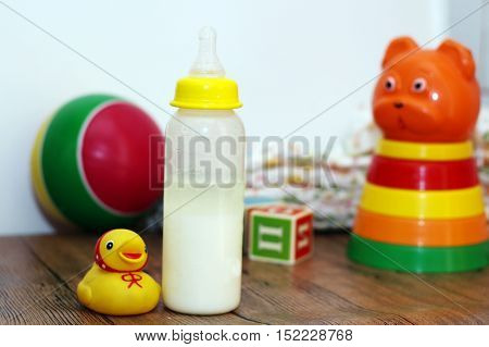 Baby milk and toys collection wooden train