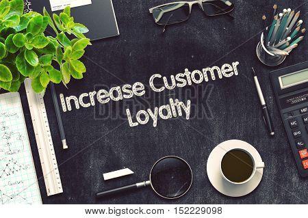 Increase Customer Loyalty on Black Chalkboard. 3d Rendering. Toned Image.