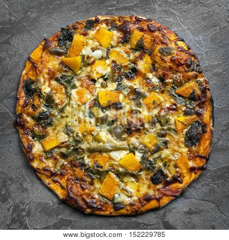 Vegetarian pizza, top view on slate.