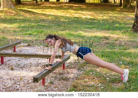 Young Woman Doing Doing Push-ups