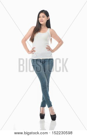 full length picture of a casual young woman standing with her hands on her hips