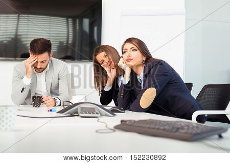 Business team sitting sad and solving problem in office