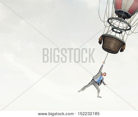 Man traveling in aerostat . Mixed media