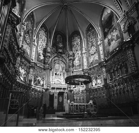MONTSERRAT SPAIN - APRIL 7 2013: Interior Altar of Basilica at the Montserrat Monastery. It is a site of the Benedictine abbey which hosts the Virgin of Montserrat sanctuary. Black and white