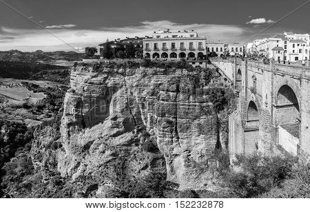 The Puente Nuevo New Bridge over Guadalevin River in Ronda Andalusia Spain. Popular landmark in the evening. Black and white
