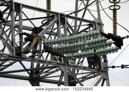 Worker on the power line during operation