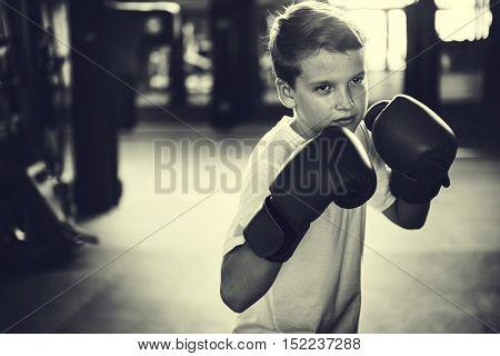 Boy Boxing Training Punching Bag Exercise Concept