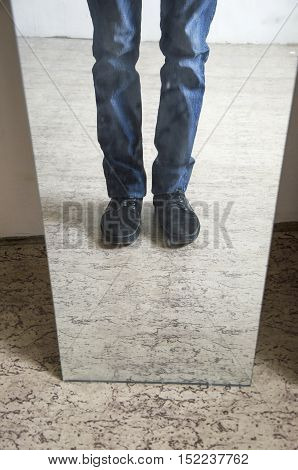 Man legs reflected in a mirror. Reflection in mirror