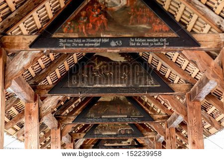 Ancient paintings on the oldest wooden bridge in Lucerne city in Switzerland