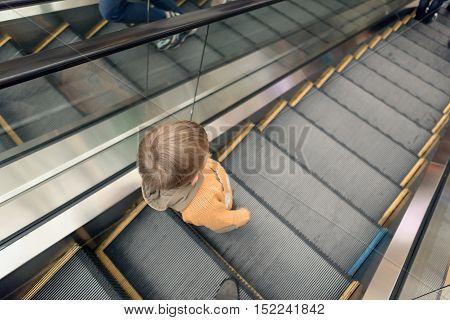 Boy Rides On An Escalator In A Big Store