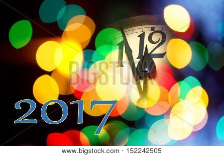 face of new year clock with text 2017