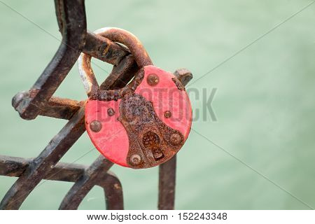 Closeup of a old rusty padlock on the bridge