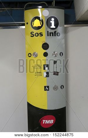 Barcelona, Spain - 24 September 2016: Barcelona metro SOS intercom machine. SOS intercom and info machine with button and mic to speak to TMB representative.