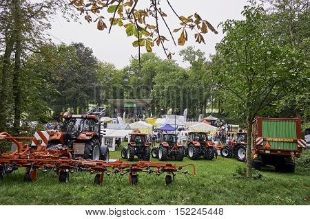 JOURE, THE NETHERLANDS - SEPTEMBER 22, 2016: Impression of Agrarische Schouw, Agricultural Fair, in Joure, The Netherlands. With tractors, equipment, tents and people.