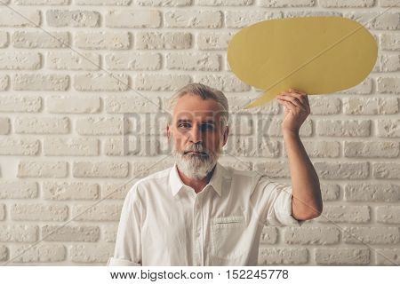Mature Man With Speech Bubble