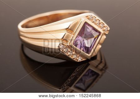 Gold ring with gem. Fashion Jewelry background