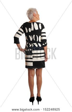 full length rear view of senior woman looking at something. isolated on white.