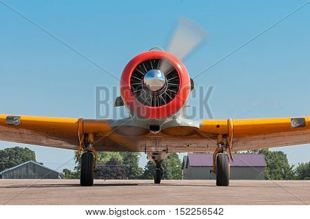 EDEN PRAIRIE MN - JULY 16 2016: AT-6G Texan airplane straight on view of running propeller. The AT-6G Texan was primarily used as an advanced trainer aircraft after World War II and into the 1950s