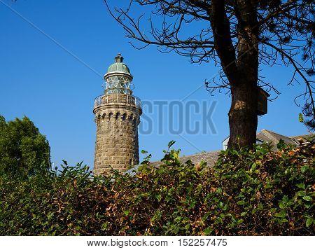 Old stone traditional lighthouse on the beach the island of Aeroe Denmark