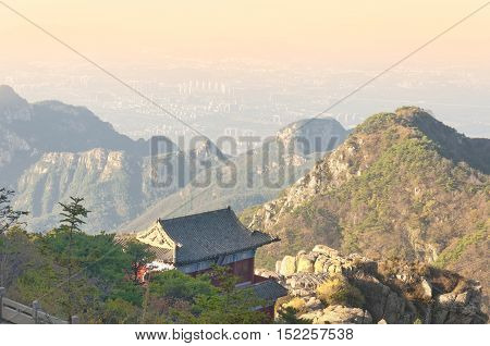 The summit of Taishan or mount Tai above the city of Tai'an in Shandong province on a sunny morning.