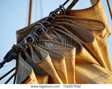 Details of gathered sail of a large classical traditional vintage tall sailing ship