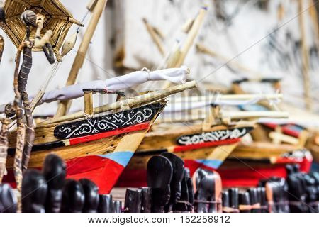 wooden handmade african toy boats at flea market