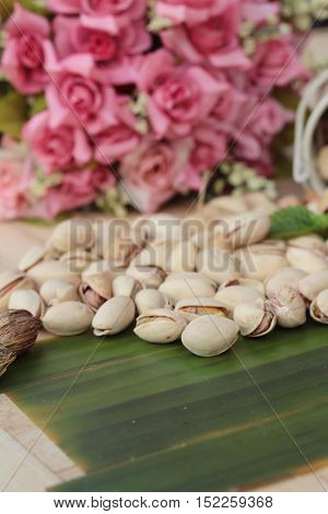 Pistachio nuts is tasty on wood background