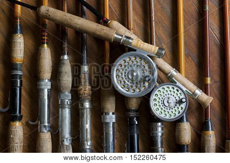 Fly Fishing Rods and Reels; Vintage gear displayed in flat lay design