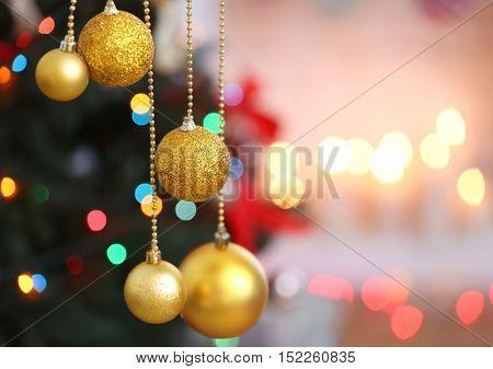 Beautiful balls on blurred Christmas lights background, closeup